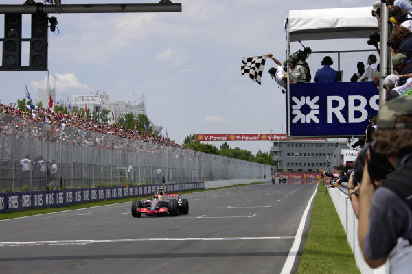 Lewis Hamilton, McLaren MP4-22 Mercedes takes the chequered flag for his first Formula 1 victory.