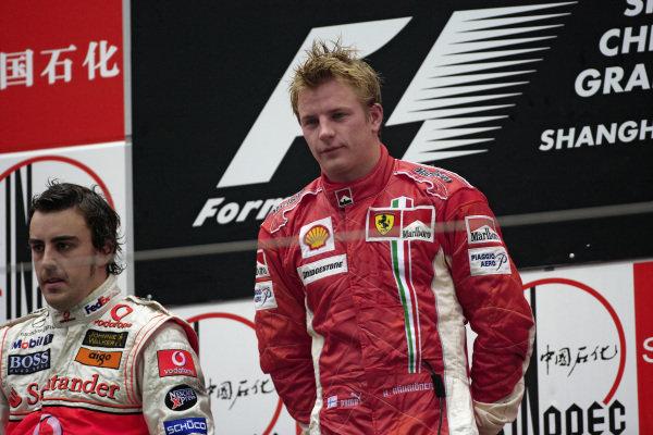 Winner Kimi Räikkönen on the podium with 2nd placed Fernando Alonso.