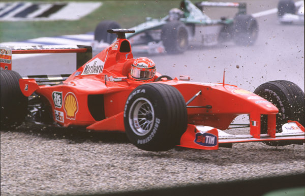 2000 German Grand Prix. Hockenheim, Germany. 28-30 July 2000. The field files through after Michael Schumacher (Ferrari F1-2000) pulled across into Giancarlo Fisichella (Benetton B200 Playlife) on the approach to the Nordkurve at the start, resulting in a crash. World Copyright - Coates/LAT Photographic crash sequence 08. ref: 35mm A08