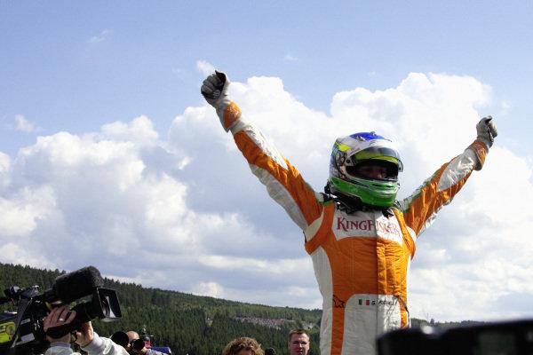 Giancarlo Fisichella celebrates a surprise pole position.