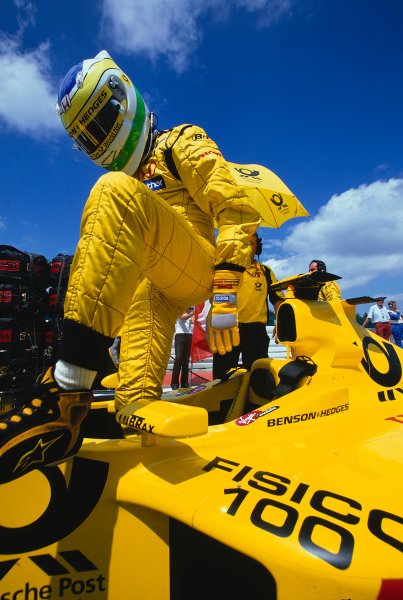 2002 European Grand Prix, Nurburgring, Germany. 23rd June 2002 Giancarlo Fisichella climbs into the Jordan for his 100th GP start.World Copyright: LAT PhotographicRef: 35mm transparency