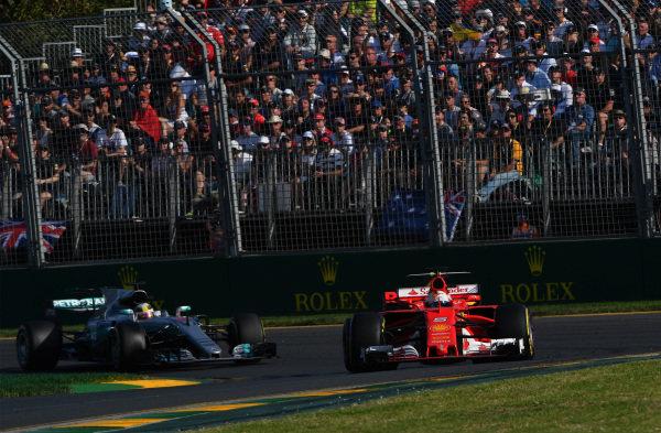 Sebastian Vettel (GER) Ferrari SF70-H leads Lewis Hamilton (GBR) Mercedes-Benz F1 W08 Hybrid Sebastian Vettel (GER) Ferrari SF70-H leads Lewis Hamilton (GBR) Mercedes-Benz F1 W08 Hybrid at Formula One World Championship, Rd1, Australian Grand Prix, Race, Albert Park, Melbourne, Australia, Sunday 26 March 2017.