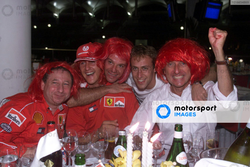 Jean Todt, Michael Schumacher, Rubens Barrichello, Luca Badoer and Luca di Montezemolo celebrate another Ferrari world championship.