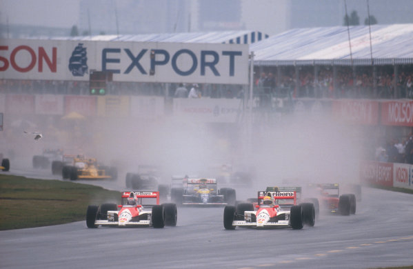 1990 Canadian Grand Prix.Montreal, Canada.8-10 June 1990.Ayrton Senna and Gerhard Berger (both McLaren MP4/5B Honda's) lead at the start.Ref-90 CAN 04.World Copyright - LAT Photographic