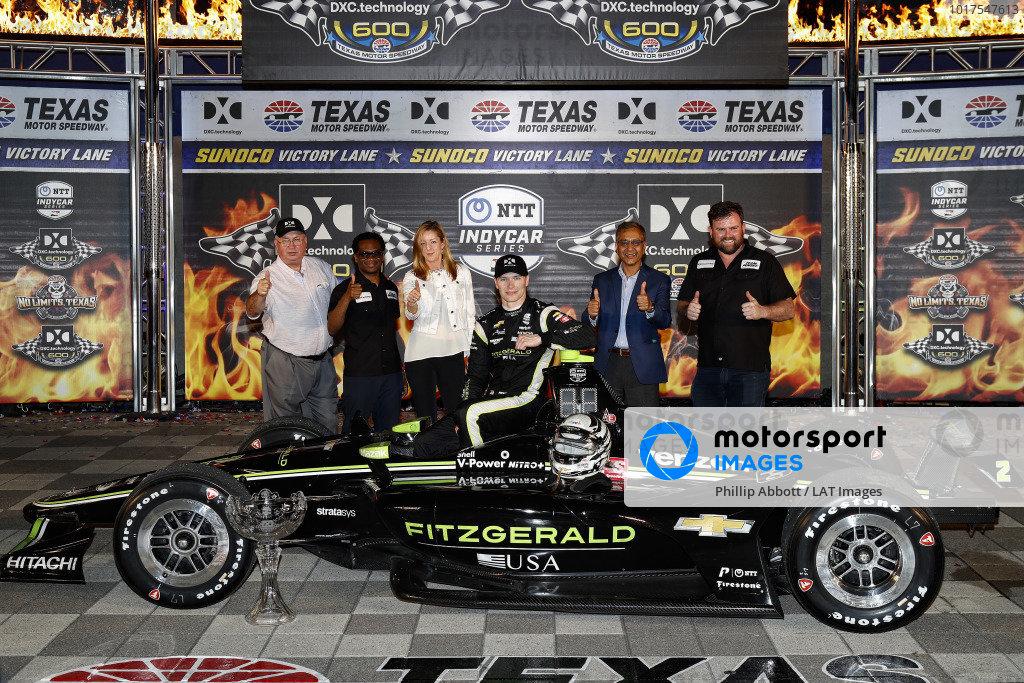 Josef Newgarden, Team Penske Chevrolet celebrates with  DXC guests in victory lane