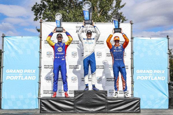 #10: Alex Palou, Chip Ganassi Racing Honda, #27: Alexander Rossi, Andretti Autosport Honda, #9: Scott Dixon, Chip Ganassi Racing Honda celebrate on the podium