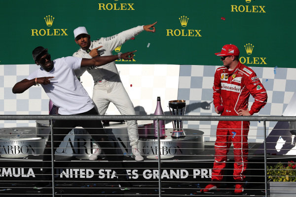 Race winner Lewis Hamilton (GBR) Mercedes AMG F1 celebrates on the podium with Usain Bolt (JAM) and Kimi Raikkonen (FIN) Ferrari at Formula One World Championship, Rd17, United States Grand Prix, Race, Circuit of the Americas, Austin, Texas, USA, Sunday 22 October 2017.
