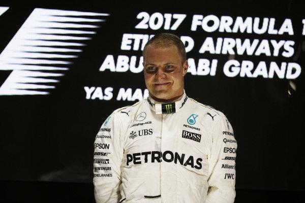 Race winner Valtteri Bottas (FIN) Mercedes AMG F1 celebrates on the podium at Formula One World Championship, Rd20, Abu Dhabi Grand Prix, Race, Yas Marina Circuit, Abu Dhabi, UAE, Sunday 26 November 2017. BEST IMAGE