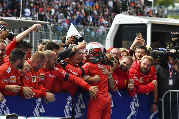 Charles Leclerc, Ferrari, 1st position, celebrates with his team in Parc Ferme