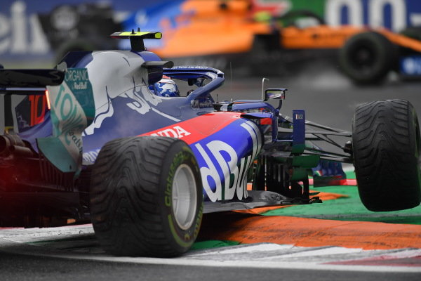 Pierre Gasly, Toro Rosso STR14, spins over a kerb