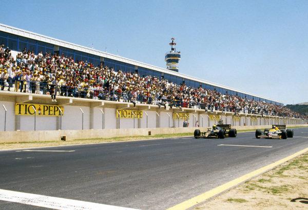 Race winner Ayrton Senna (BRA) Lotus 98T (left) beats Nigel Mansell (GBR) Williams FW11, by 0.014s making it the second closest finish of all time. Spanish Grand Prix, Rd2, Jerez, Spain, 13 April 1986.