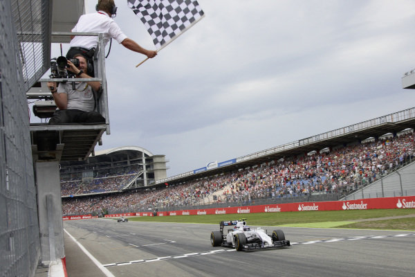 Valtteri Bottas, Williams FW36 Mercedes, crosses the finish line to take a podium finish.