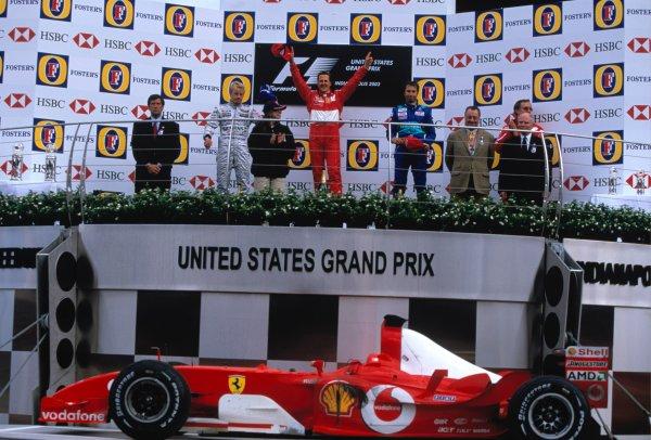 2003 United States Grand PrixIndianapolis, USA. 26th - 28th October 2003Michael Schumacher, Ferrari F2003 GA, Kimi Raikkonen, Team McLaren Mercedes MP4-17D, Heinz-Harald Frentzen, Sauber Petronas C22 on podium.World Copyright: spinref: 35mm Image 03AMER23