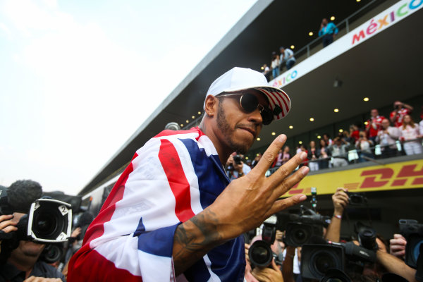 Autodromo Hermanos Rodriguez, Mexico City, Mexico. Sunday 29 October 2017. Lewis Hamilton, Mercedes AMG, with Union flag across his shoulders, holds four fingers up in celebration of becoming the first British 4 times world champion in history. World Copyright: Charles Coates/LAT Images  ref: Digital Image DJ5R7898