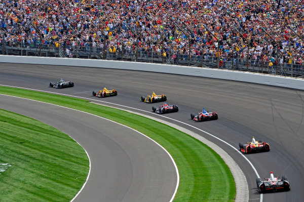26 May, 2013, Indianapolis, Indiana, USA Tony Kanaan (#11) leads out turn one over Carlos Munoz (#26), Ryan Hunter-Reay (#1), Marco Andretti (#25), Justin Wilson (#19), Helio Castroneves (#3) and AJ Allmendinger (#2). ©2013, F. Peirce Williams LAT Photo USA