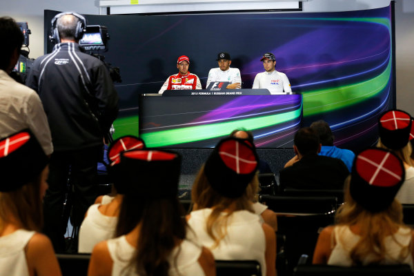 Sochi Autodrom, Sochi, Russia. Sunday 11 October 2015. Lewis Hamilton, Mercedes AMG, 1st Position, Sebastian Vettel, Ferrari, 2nd Position, and Sergio Perez, Force India, 3rd Position, in the Press Conference. World Copyright: Alastair Staley/LAT Photographic ref: Digital Image _79P1488