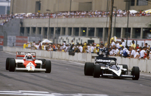 Detroit, Michigan, U.S A.20-22 June 1986.Alain Prost (McLaren MP4/2C-TAG Porsche), 3rd position, passes Riccardo Patrese (Brabham BT55-BMW), 6th position, action. World Copyright: LAT Photographic.Ref:  86USA