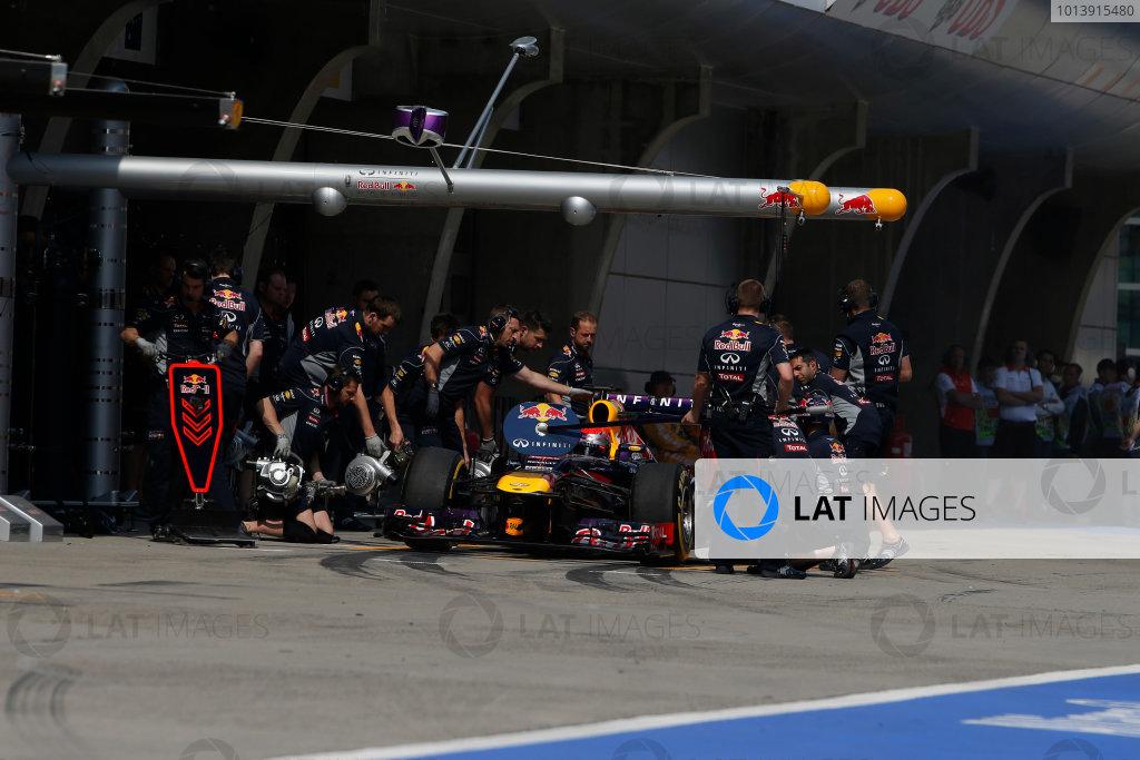 Shanghai International Circuit, Shanghai, China Saturday 13th April 2013 Sebastian Vettel, Red Bull RB9 Renault, in the pits. World Copyright: Glenn Dunbar/LAT Photographic ref: Digital Image _89P7182