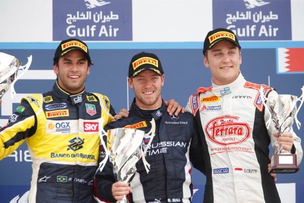 2013 GP2 Series. Round 2.  Bahrain International Circuit, Sakhir, Bahrain. 21st April.  Sunday Race.  Sam Bird (GBR, RUSSIAN TIME) celebrates his victory on the podium with Felipe Nasr (BRA, Carlin) and Stefano Coletti (MON, Rapax).  World Copyright: Glenn Dunbar/GP2 Series Media Service. Ref: _89P4384