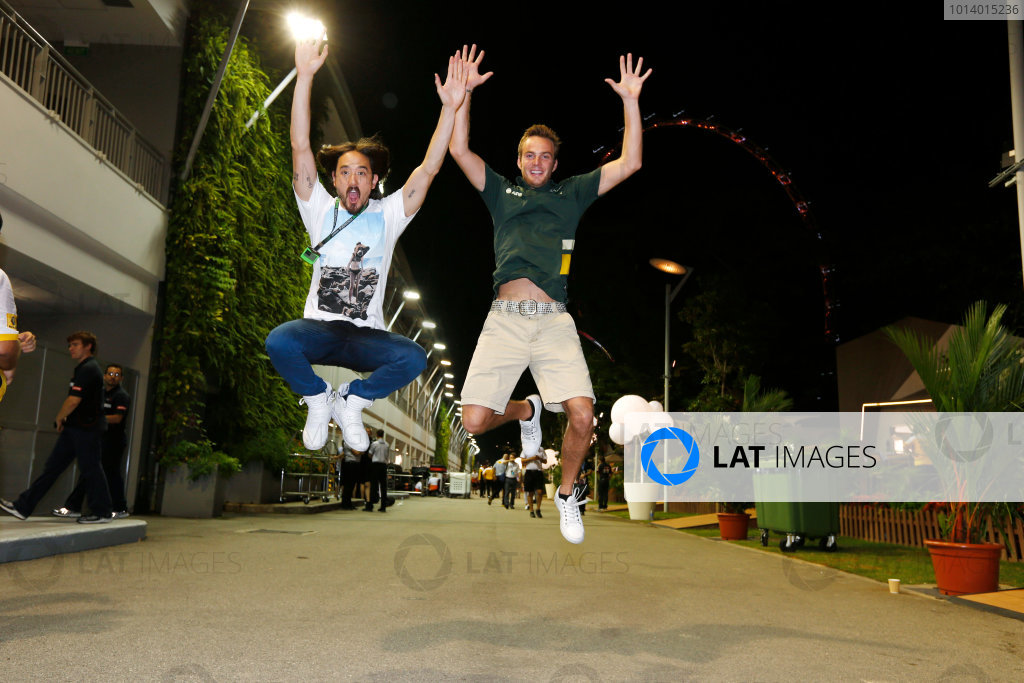 Marina Bay Circuit, Singapore. Saturday 21st September 2013. Giedo van der Garde, Caterham CT03 Renault jumps in the paddock with a friend. World Copyright: Charles Coates/LAT Photographic. ref: Digital Image _N7T5627