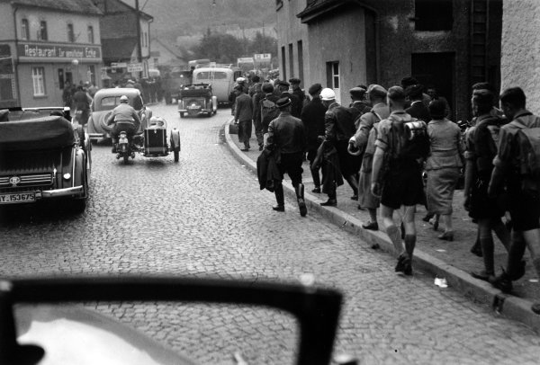 Nurburgring, Germany. 25th July 1937.  Crowds walk through the streets towards the track.  Ref: RF37_GER_02. World Copyright: Robert Fellowes/LAT Photographic