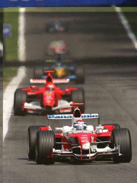 2005 Italian Grand Prix - Sunday Race,Monza, Italy. 4th September 2005 Jarno Trulli, Toyota TF105 leads Michael Schumacher, Ferrari F2005. Action.World Copyright: Steve Etherington/LAT Photographic ref: 48mb Hi Res Digital Image