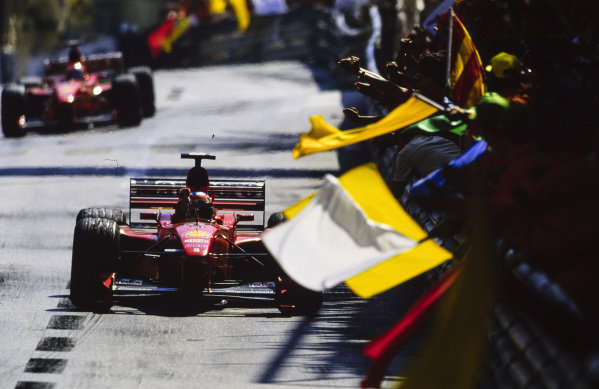 Michael Schumacher, Ferrari F399, celebrates victory.