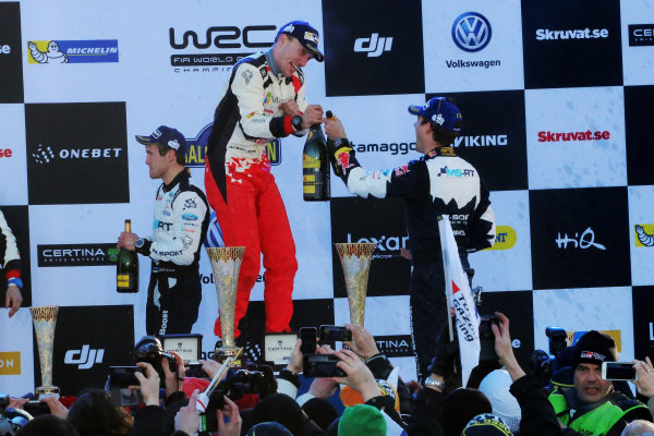 Rally winner Jari-Matti Latvala (FIN), Toyota Gazoo Racing WRC and third placed  Sebastien Ogier (FRA), M-Sport World Rally Team WRC celebrate on the podium with the champagne at World Rally Championship, Rd2, Rally Sweden, Day Three, Karlstad, Sweden, 12 February 2017.