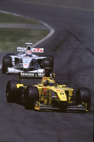 1999 Canadian Grand Prix.Montreal, Quebec, Canada.11-13 June 1999.Heinz-Harald Frentzen (Jordan 199 Mugen Honda) leads Johnny Herbert (Stewart SF3 Ford).Ref-99 CAN 17.World Copyright - LAT Photographic