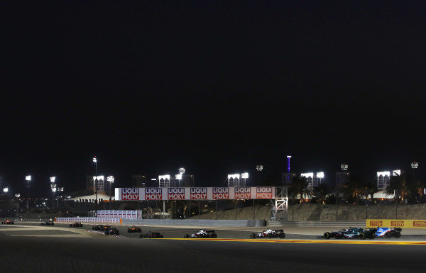 Kimi Raikkonen, Alfa Romeo Racing C41, leads Antonio Giovinazzi, Alfa Romeo Racing C41, Sebastian Vettel, Aston Martin AMR21, and Esteban Ocon, Alpine A521