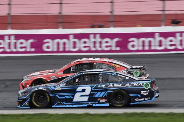 #2: Brad Keselowski, Team Penske, Ford Mustang eCascadia, #20: Christopher Bell, Joe Gibbs Racing, Toyota Camry Rheem/Watts
