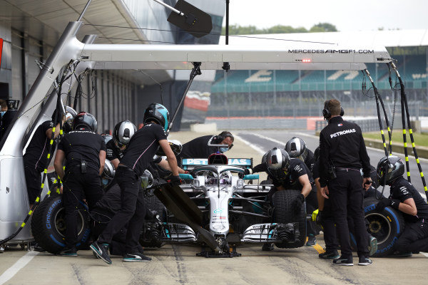 Lewis Hamilton in the pits in a Mercedes W09