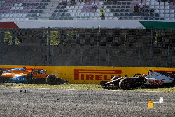 Carlos Sainz, McLaren MCL35, and Kevin Magnussen, Haas VF-20, crash out