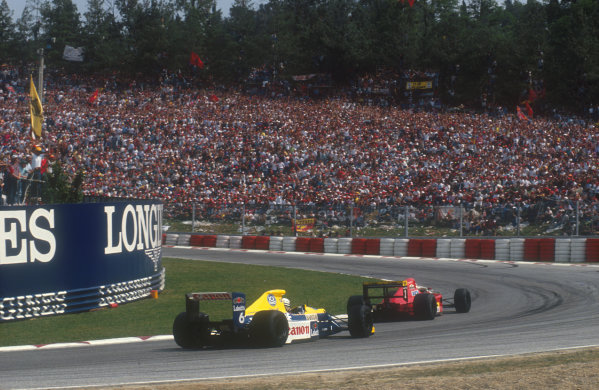 1990 San Marino Grand Prix.Imola, Italy.11-13 May 1990.Nigel Mansell (Ferrari 641) heads Riccardo Patrese (Williams FW13B Renault) in the battle for 2nd place.Ref-90 SM 09.World Copyright - LAT Photographic