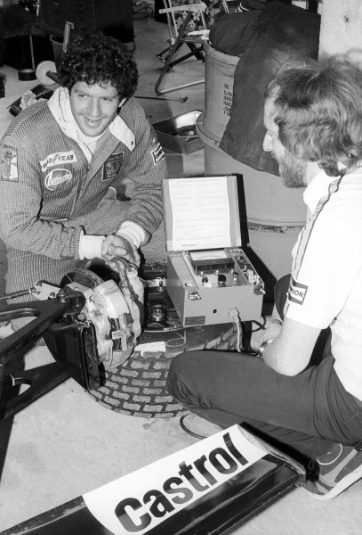 A Wolf mechanic uses a Castrol Vapour Lock Indicator on the Wolf WR5 of Jody Scheckter (RSA) (Left), who retired from the race on lap 37 with a broken gearbox.