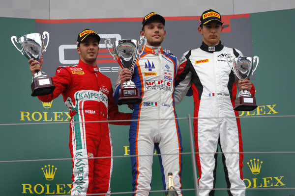 (L to R): Antonio Fuoco (ITA) Carlin, Race winner Luca Ghiotto (ITA) Trident and Esteban Ocon (FRA) ART Grand Prix celebrate with the trophy on the podium at GP3 Series, Rd2, Spielberg, Austria, 19-21 June 2015.