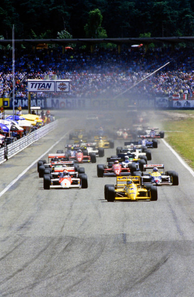 Ayrton Senna, Lotus 99T Honda, leads at the start of the race.