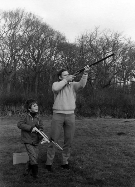 R-L: Graham Hill (GBR) Lotus, and son Damon Hill (GBR) on a clay pigeon shoot. Graham Hill Photo Shoot, England, 1968.