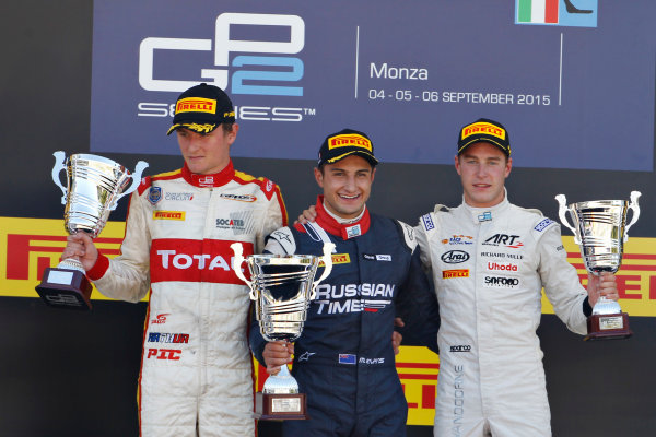 2015 GP2 Series Round 8. Autodromo Nazionale di Monza, Monza, Italy. Sunday 6 September 2015. Mitch Evans (NZL, RUSSIAN TIME) celebrates on the podium with Arthur Pic (FRA, Campos Racing) and Stoffel Vandoorne (BEL, ART Grand Prix). World Copyright: Sam Bloxham/LAT Photographic. ref: Digital Image _G7C2251