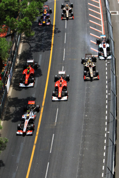 Romain Grosjean (FRA) Lotus E20 and Michael Schumacher (GER) Mercedes AMG F1 W03 collide at the start of the race. Formula One World Championship, Rd6, Monaco Grand Prix, Race Day, Monte-Carlo, Monaco, Sunday 27 May 2012.