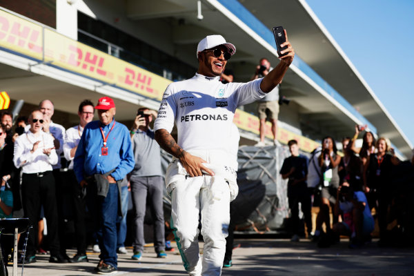 Circuit of the Americas, Austin, Texas, United States of America. Sunday 22 October 2017. Lewis Hamilton, Mercedes AMG, takes a selfie as he celebrates winning the Constructors' Championship with his team. World Copyright: Zak Mauger/LAT Images  ref: Digital Image _56I3738