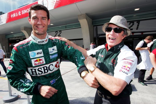 (L to R): Mark Webber (AUS) Jaguar and Jackie Stewart (GBR) compare their Rolex watches! Formula One World Championship, Rd16, Chinese Grand Prix, Preparations, Shanghai, China, 23 September 2004. DIGITAL IMAGE