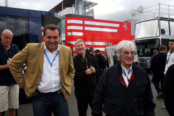 Simon Gillett (GBR) Donington Park Owner with Bernie Ecclestone (GBR) F1 Supremo (Right). Formula One World Championship, Rd 8, British Grand Prix, Qualifying Day, Silverstone, England, Saturday 20 June 2009.