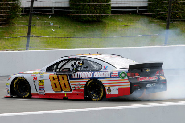 6-8 June, 2014, Long Pond, Pennsylvania USA Dale Earnhardt Jr celebrates with victory with a burn out ?2014, Lesley Ann Miller LAT Photo USA