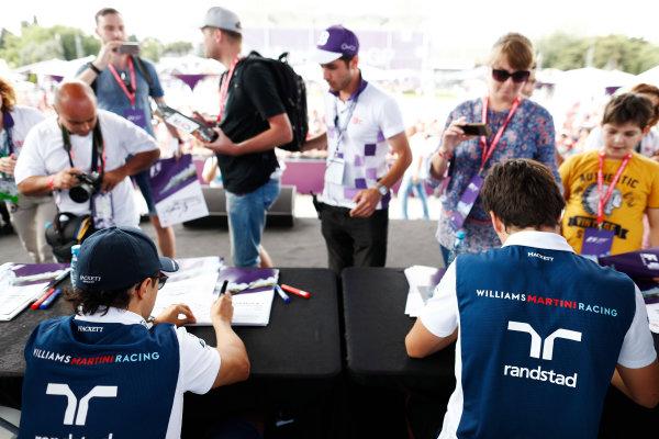 Baku City Circuit, Baku, Azerbaijan. Friday 23 June 2017. Felipe Massa, Williams Martini Racing, and Lance Stroll, Williams Martini Racing, sign autographs for fans. World Copyright: Glenn Dunbar/LAT Images ref: Digital Image _X4I0457