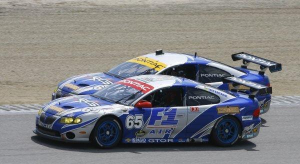 5 - 7  May 2006, Mazda Raceway Laguna Seca, Monterey, California , USAPair of TRG Pontiac GTO Rs at speed.Copyright 2006, Richard Dole, USA LAT Photographic