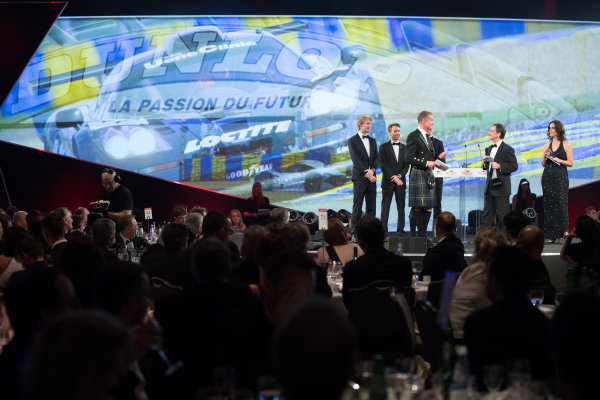 2017 Autosport Awards Grosvenor House Hotel, Park Lane, London. Sunday 3 December 2017. WEC Champions Brendon Hartley, Timo Bernhard and Earl Bamber present the John Bolster award to Pierre Fillon on behalf of the Automobile Club de l'Ouest. World Copyright: Zak Mauger/LAT Images  ref: Digital Image _O3I7344