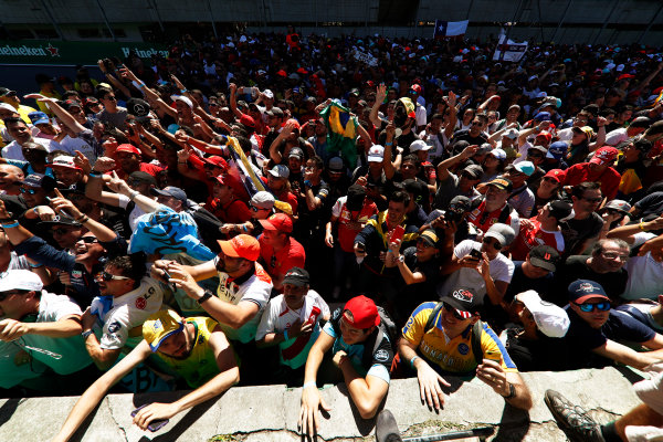 Interlagos, Sao Paulo, Brazil. Sunday 12 November 2017. Fans gather at the podium after the race. World Copyright: Glenn Dunbar/LAT Images  ref: Digital Image _X4I3971