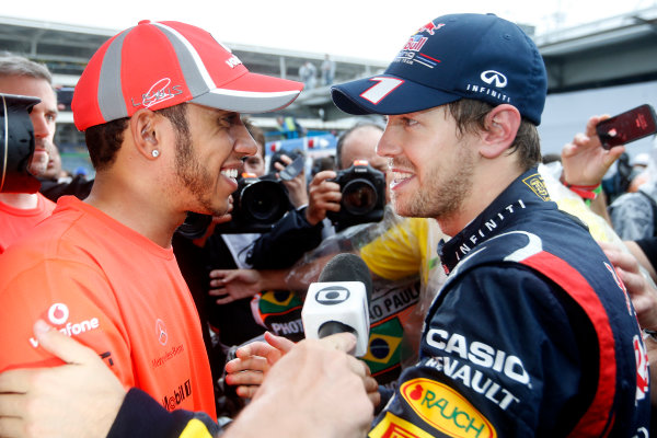 Interlagos, Sao Paulo, Brazil. Sunday 25th November 2012. Lewis Hamilton, McLaren, congratulates World Champion Sebastian Vettel, Red Bull Racing.  World Copyright:Glenn Dunbar/LAT Photographic ref: Digital Image _89P9437