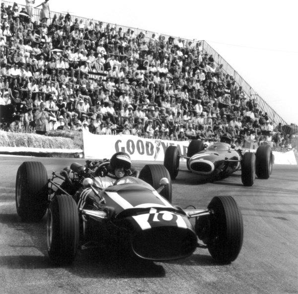 1966 Monaco Grand Prix.Monte Carlo, Monaco. 22 May 1966.Jochen Rindt, Cooper T81-Maserati, retired, leads Graham Hill, BRM P261, 3rd position, action.World Copyright: LAT PhotographicRef: 34097